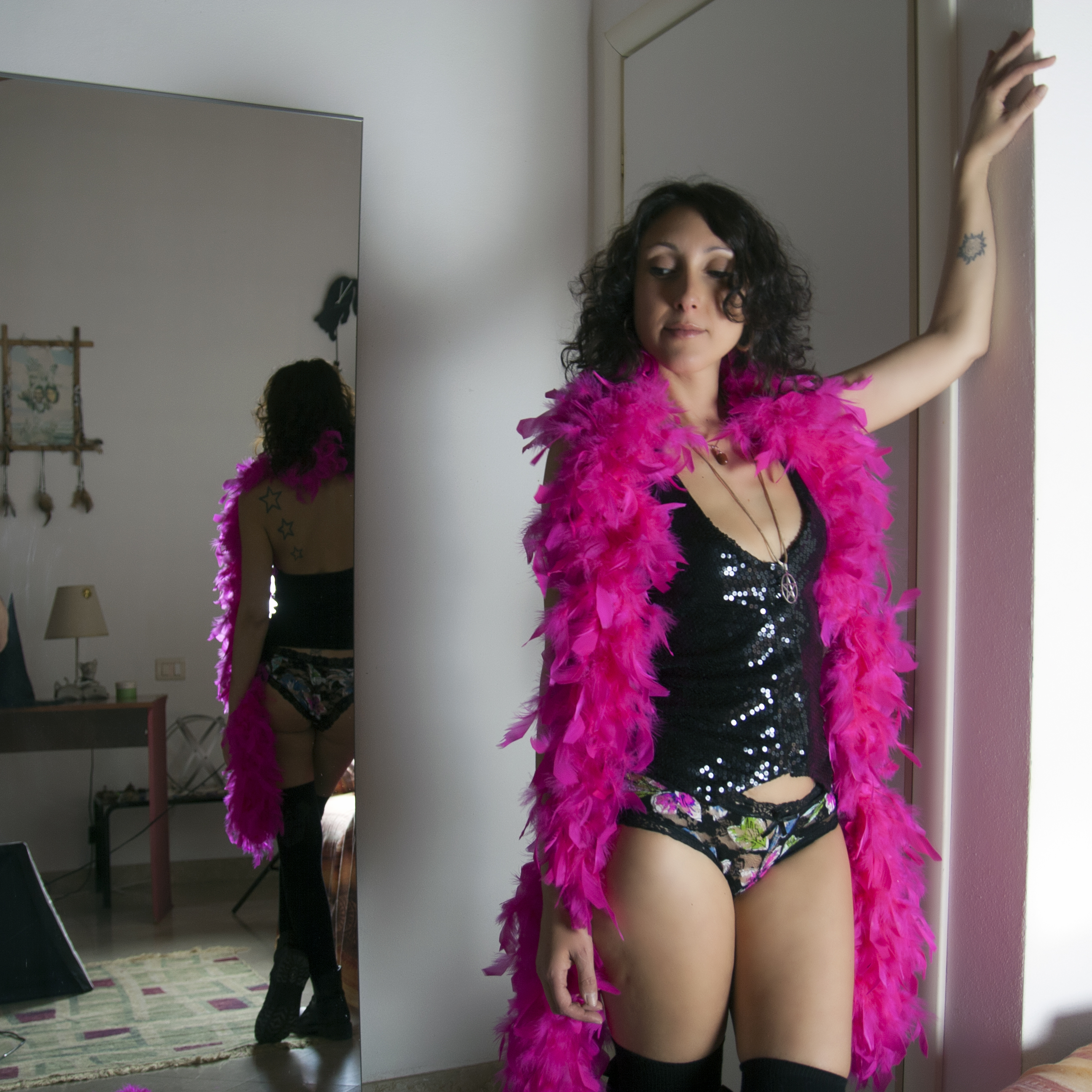 Pink Boa in the mirror